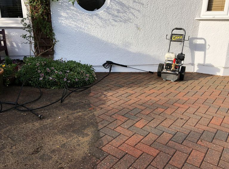 before and after paved drive jet wash service north wales deganwy